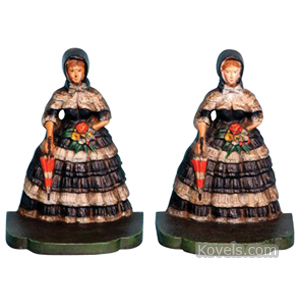 Bookends Victorian Lady Layered Dress Parasol Flowers Painted Cast Iron Bradley Hubbard | Kovels' Price Guide