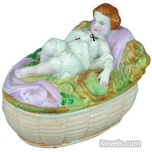 Fairing Box Child With Cross Lying On Ground Pink Blanket Bisque